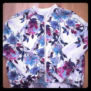Floral print jacket with gold zipper